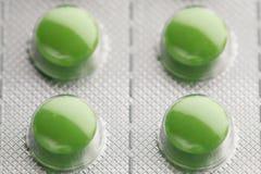 Πακέτο φουσκαλών με τα πράσινα χάπια Στοκ εικόνα με δικαίωμα ελεύθερης χρήσης