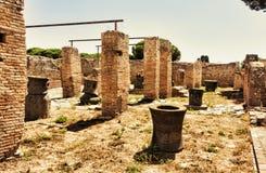 Παλάτι Molini με millstones λάβας - Ostia Antica - Ρώμη Στοκ Εικόνες