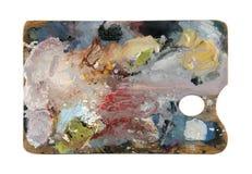 Παλέτα καλλιτεχνών ` s με τα πολλαπλάσια χρώματα που απομονώνονται στο άσπρο υπόβαθρο Στοκ Εικόνες