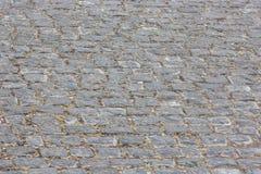 Παλαιά άποψη της monotone γκρίζας πέτρας τούβλου στο έδαφος για το δρόμο οδών στοκ εικόνες με δικαίωμα ελεύθερης χρήσης