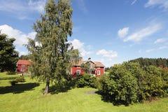 Παλαιά εξοχικά σπίτια και τοπίο Στοκ Φωτογραφία