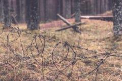 παλαιά ξύλινα trenshes στη Λετονία - εκλεκτής ποιότητας αναδρομική επίδραση Στοκ φωτογραφία με δικαίωμα ελεύθερης χρήσης
