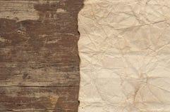 Παλαιά περγαμηνή στο ξύλινο υπόβαθρο Στοκ Φωτογραφία