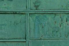 Παλαιά σύσταση μετάλλων που ντύνεται με το παλαιό πράσινο χρώμα στοκ φωτογραφίες