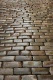 Παλαιά υγρή οδός κυβόλινθων στην αυγή γεωμετρικός παλαιός τρύγος εγγράφου διακοσμήσεων ανασκόπησης Στοκ Φωτογραφία