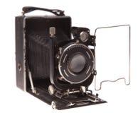 Παλαιά φωτογραφική μηχανή σε μια άσπρη ανασκόπηση Στοκ φωτογραφία με δικαίωμα ελεύθερης χρήσης