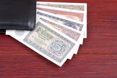 Παλαιά χρήματα από τη Γερμανία στο μαύρο πορτοφόλι Στοκ φωτογραφίες με δικαίωμα ελεύθερης χρήσης