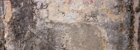 Παλαιός, στενοχωρημένος τοίχος, υπόβαθρο σύστασης προσόψεων οικοδόμη στοκ εικόνα με δικαίωμα ελεύθερης χρήσης