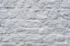 Παλαιός τοίχος από μια άσπρη κινηματογράφηση σε πρώτο πλάνο υποβάθρου τούβλου στοκ φωτογραφία με δικαίωμα ελεύθερης χρήσης