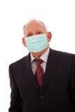 Παλαιότερος επιχειρηματίας με μια μάσκα Στοκ Εικόνες
