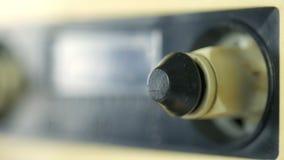 Παλαιό ακουστικό παιχνίδι εξελίκτρων κασετών Κινηματογράφηση σε πρώτο πλάνο φιλμ μικρού μήκους