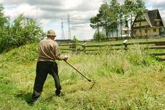 παλαιό δρεπάνι ατόμων Στοκ Εικόνες