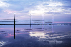 παλαιό ηλιοβασίλεμα φραγών παραλιών Στοκ Φωτογραφίες