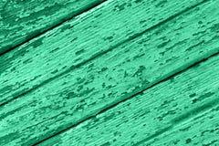 Παλαιό ξύλινο υπόβαθρο των πινάκων με το ραγισμένο και χρώμα αποφλοίωσης στοκ φωτογραφία
