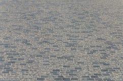 Παλαιό πεζοδρόμιο πετρών στο δρόμο πόλεων Στοκ Φωτογραφίες