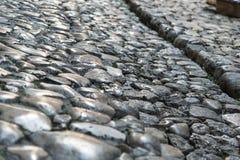 Παλαιό πεζοδρόμιο πόλης πετρών Στοκ Εικόνα