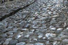 Παλαιό πεζοδρόμιο πόλης πετρών Στοκ εικόνες με δικαίωμα ελεύθερης χρήσης