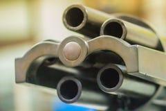 Παλαιό πυροβόλο όπλο Gatling, μια από την πιό γνωστή πρόωρη γρήγορος-πυρκαγιά συμπιεζόμενη δί ελατηρίου Το πυροβόλο όπλο Gatling  Στοκ Φωτογραφίες