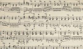 Παλαιό φύλλο μουσικής με τις σημειώσεις, υπόβαθρο Στοκ εικόνα με δικαίωμα ελεύθερης χρήσης