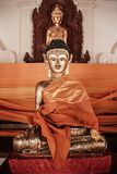 Παλαιό χρυσό γλυπτό του Βούδα στο Si Thamm Wat Phra Mahathat Nakhon Στοκ φωτογραφία με δικαίωμα ελεύθερης χρήσης