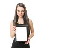 Πανέμορφη επιχειρηματίας που παρουσιάζει υπολογιστή ταμπλετών στοκ εικόνα με δικαίωμα ελεύθερης χρήσης