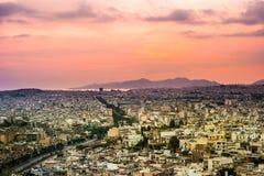 Πανόραμα της Αθήνας στο ηλιοβασίλεμα όμορφη εικονική παράσταση & Στοκ εικόνες με δικαίωμα ελεύθερης χρήσης