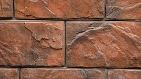 Πανόραμα της διακοσμητικής πέτρας Κίνηση επάνω ο γρανίτης στο σπίτι τοίχος πετρών φιλμ μικρού μήκους