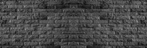 Πανόραμα του μαύρου τουβλότοιχος της σκοτεινών σύστασης και του υποβάθρου πετρών στοκ εικόνες με δικαίωμα ελεύθερης χρήσης