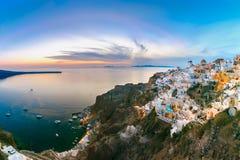Πανόραμα Oia στο ηλιοβασίλεμα, Santorini, Ελλάδα στοκ φωτογραφίες