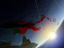Παπούα Νέα Γουϊνέα στο πρότυπο του πλανήτη Γη με το δίκτυο κατά τη διάρκεια της ανατολής Έννοια της νέας τεχνολογίας, της επικοιν ελεύθερη απεικόνιση δικαιώματος