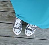 Παπούτσια αντισφαίρισης με το φόρεμα Στοκ εικόνες με δικαίωμα ελεύθερης χρήσης