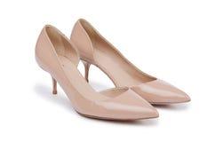 Παπούτσια γυναικών στο άσπρο υπόβαθρο στοκ εικόνες