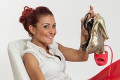 Παπούτσια εκμετάλλευσης γυναικών Στοκ Φωτογραφία