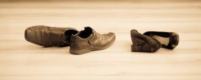 Παπούτσια μαύρων γυναικών και των ατόμων Στοκ Φωτογραφία