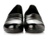 Παπούτσια μαύρων γυναικών που απομονώνονται στην άσπρη ανασκόπηση Στοκ φωτογραφία με δικαίωμα ελεύθερης χρήσης