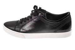 Παπούτσια μαύρων γυναικών ` s με τις δαντέλλες στα άσπρα πέλματα Στοκ Εικόνα