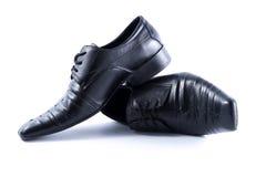 Παπούτσια μαύρων στο άσπρο υπόβαθρο Στοκ εικόνα με δικαίωμα ελεύθερης χρήσης