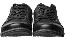 Παπούτσια μαύρων ` s με τα κορδόνια που απομονώνονται Στοκ Εικόνες