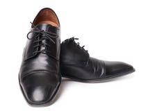 Παπούτσια μαύρων ` s που απομονώνονται στο άσπρο υπόβαθρο Στοκ Εικόνες