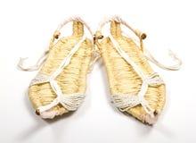 Παπούτσια χλόης στην άσπρη ανασκόπηση Στοκ φωτογραφία με δικαίωμα ελεύθερης χρήσης