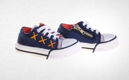 παπούτσι ή όμορφα παπούτσια μικρών παιδιών σε ένα υπόβαθρο Στοκ Φωτογραφία