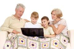 Παππούς και γιαγιά με τα παιδιά Στοκ Εικόνες