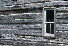 παράθυρο κούτσουρων καμ Στοκ Φωτογραφίες