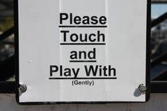 Παρακαλώ αγγίξτε και παίξτε με ήπια Στοκ Εικόνες