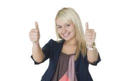 Παρακινημένη γυναίκα που δίνει τους διπλούς αντίχειρες επάνω Στοκ Εικόνες