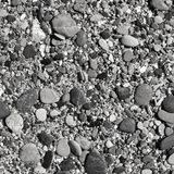 Παραλία βοτσάλων σε γραπτό Στοκ Φωτογραφίες