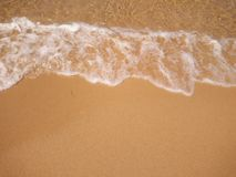 Παραλία κυμάτων και άμμου Στοκ Φωτογραφίες