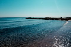 Παραλία της Βουλγαρίας, μαύρη άμμος σύστασης στην έννοια διακοπών παραλιών, υπόβαθρο, φυσικό υπόβαθρο Στοκ εικόνα με δικαίωμα ελεύθερης χρήσης