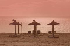 Παραλία τριών parasols στοκ φωτογραφίες