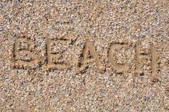 παραλία λέξης στην άμμο Στοκ φωτογραφία με δικαίωμα ελεύθερης χρήσης